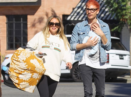 Luca Cruz Comrie's mother Hillary Duff with her boyfriend Matthew Koma and a newly born baby