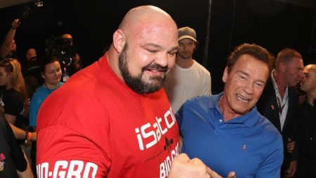 Brian Shaw poses with Arnold Schwarzenegger
