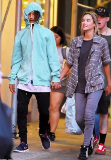 Smith holding hands with his then girlfriend Stella Hudgens.
