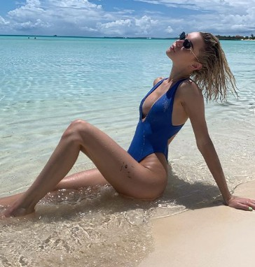 Sarah Snyder sun bathing during her vacation.