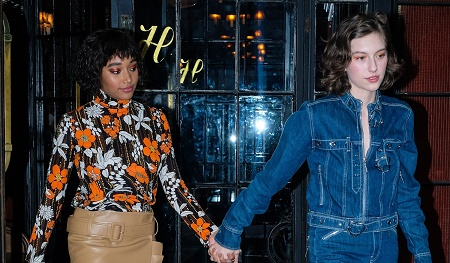 Amandla Stenberg and her girlfriend King Princess hold hands as they head to the MTV VMAs