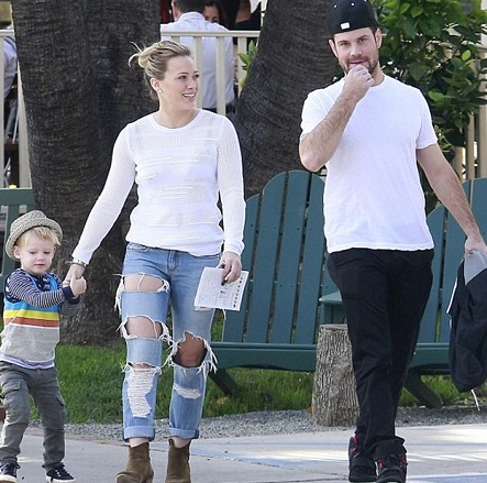 Mike Comrie with his former wife and child