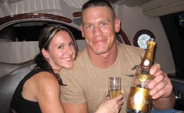 Photo: Elizabeth Huberdeau and John Cena at their own automobile
