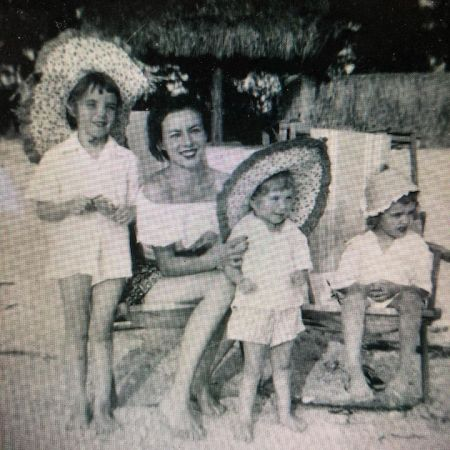 Childhood photo of Lauren Cook with her grandma and siblings