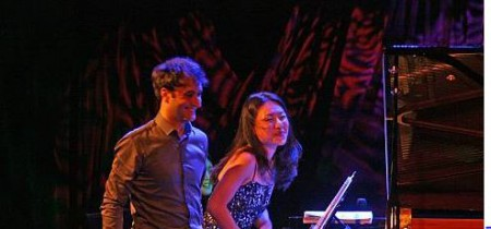 Soyeon Kate Lee and her husband, Ran performing a duet