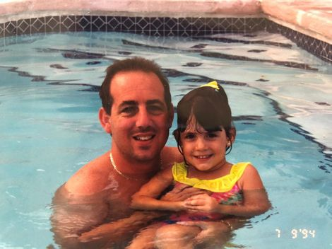 Caitlin Dechelle with her father in her early days