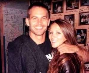 Meadow Rain Walker's parents Rebecca Soteros & Paul Walker hugging each other. The picture is while the pair were together