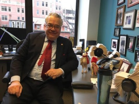 John Gizzi posing for a photo while in his office