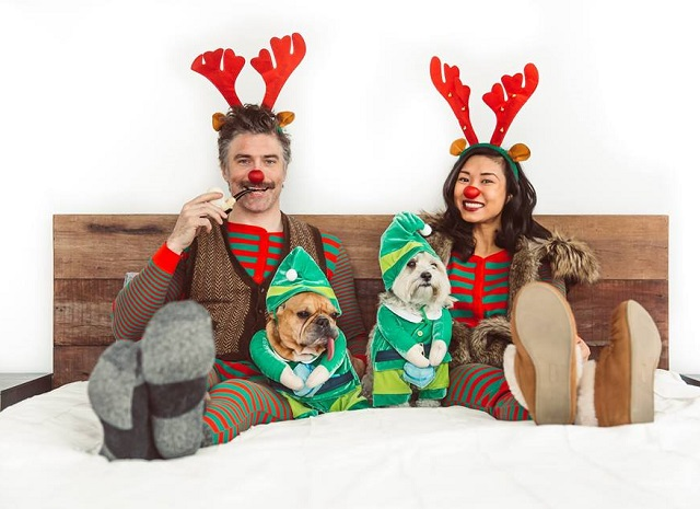 Anson Mount and Darah Trang with their pet dogs during Christmas