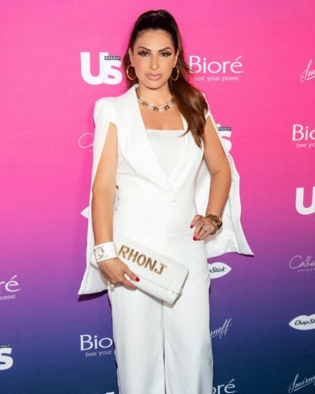 Jennifer Aydin is promoting Island to East Side's hand bag, RHONJ in an award function in 2019