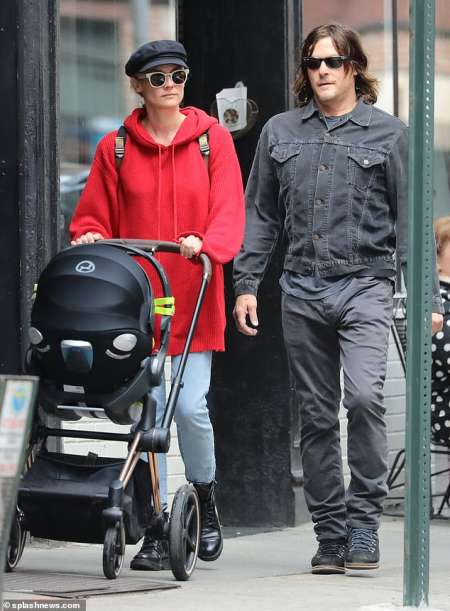 Diane Kruger and Norman Reedus taking their newly born child for a walk