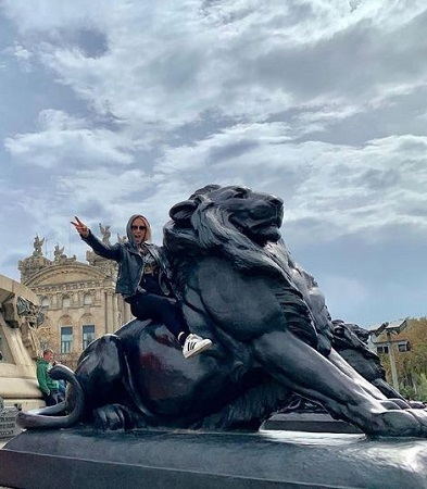Image: Emma chilling in Barcelona riding on a lion's statue