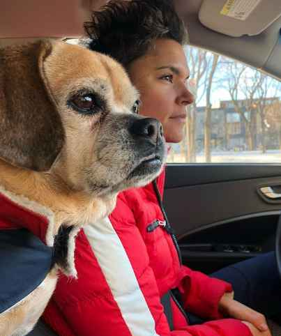 Kate Fagan in her car with her dog. net worth, earning, income