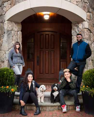 David Ortiz with his family in front of his house
