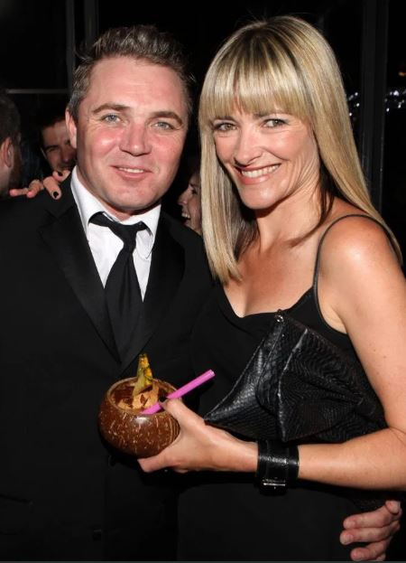 Jennifer Woodburne with her husband, Alex Ferns.