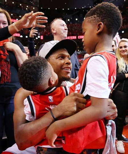 NBA star, Kyle Lowry with his two sons