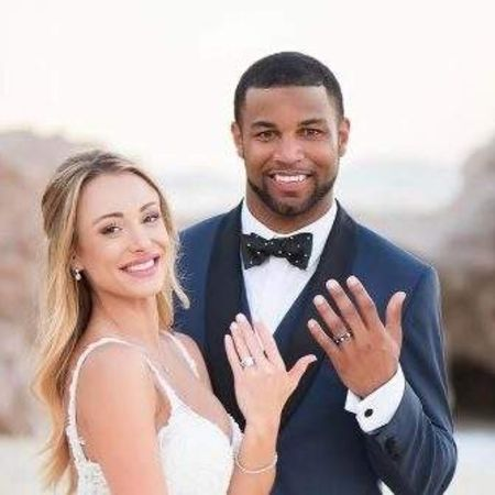Elise and her partner, Tate showing their engagement ring