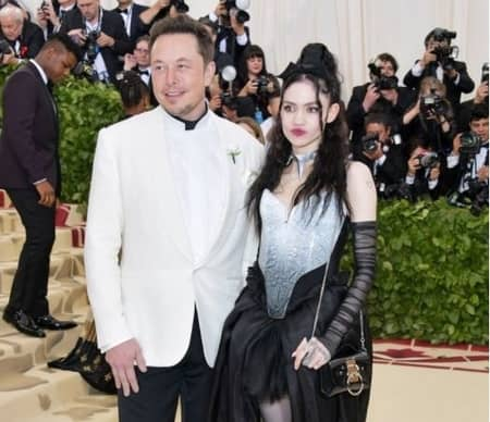 Elon Musk and his girlfriend Grimes at an event