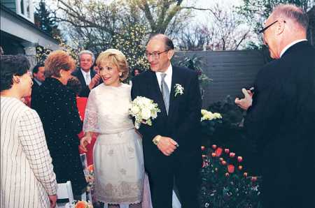Gil Jackson's ex-wife, Andrea Mitchell with Alan Greenspan during their wedding ceremony