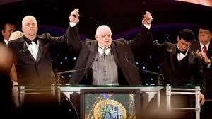 Dusty Rhodes with his son in wwe hall of fame inductance