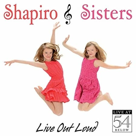 Milly with sister on cover of Live out Loud