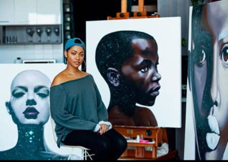 Bria alongside her art