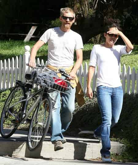 Andrew Featherston and his girlfriend Sandra Oh going on Cycling together