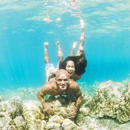 Kelly Slater and Kalani Miller swimming underwater. Know more about their adventurous love life.