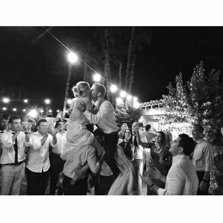 Taylor Cole and Kevin Simshauser were dancing on the shoulders of their wedding guests in a traditional way. How memorable was their wedding ceremony?