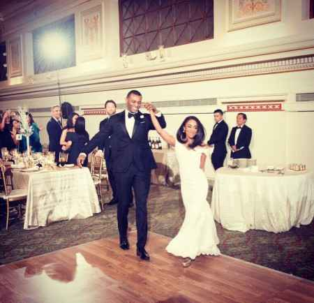 Brandon Patterson and Christie Ileto dancing at their wedding reception