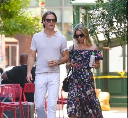 Chris Pine with his girlfriend Annabelle Wallis walking outdoors