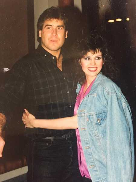 Marie Osmond hugging her second spouse, Brian Blosil
