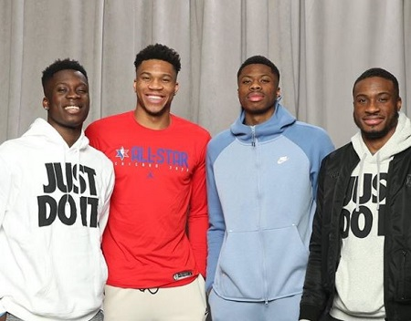 Giannis Antetokounmpo (second from left) with his NBA player brothers Alexa (left), Kostas (second from right), and Thanasis Antetokounmpo (right).