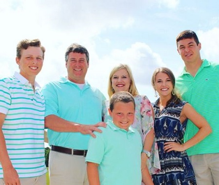 Haleigh Hughes (second from right) with her husband Nick Mullens (right), father Kiley, mother Kellie Hughes, and brothers Layton (left), Kale Sean Hughes.