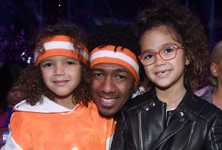 Moroccan Cannon with his twin sister and father Nick Cannon.