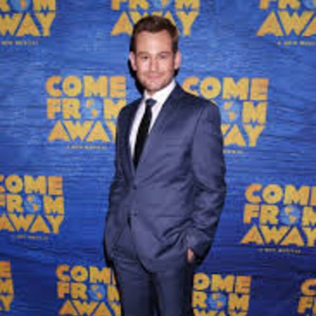 Chad at the premiere of Come From Away in blue suit