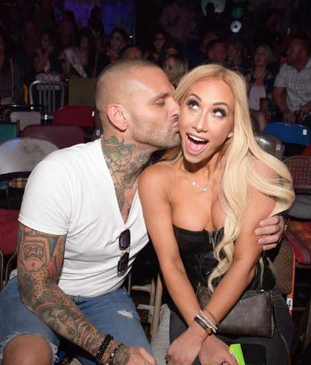 Corey Graves along with his present partner WWE star Carmella