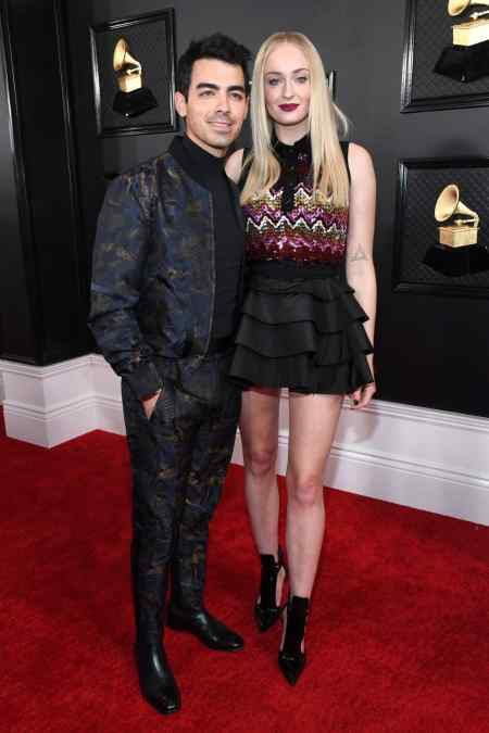 Joe Jonas and his wife, Sophie Turner arrived at the red carpet of the 62nd Annual Grammy Awards. Check out the latest news about the marital partners' upcoming baby.