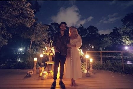 Jordan Fisher and his fiance Ellie Woods at their parents beach house after the engagement
