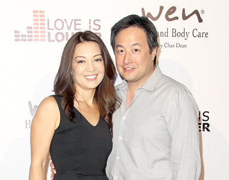 Ming-Na Wen and her husband Eric Zee at Chaz Dean's summer party benefiting Love Is Louder on August 1, 2015 in Los Angeles, California.
