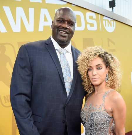 Laticia Rolle with Shaquille attending  in a event
