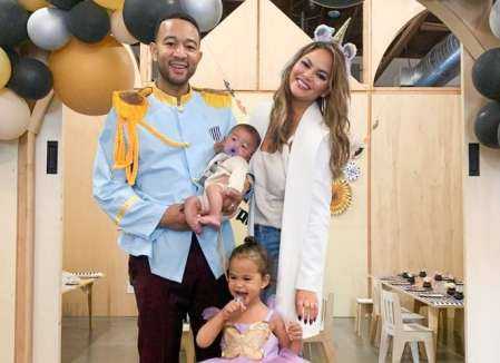 John Legend along with his wife and children