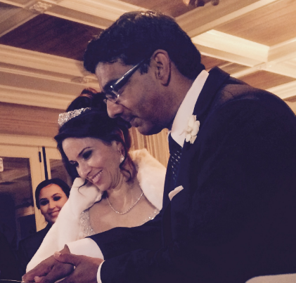 Dinesh D'Souza cutting the cake with his wife Deborah Fancher at their wedding