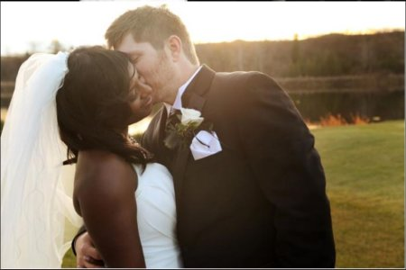 Lakeyshia Bertie and Adam Lind at their wedding ceremony. Know more about the couple's marriage.