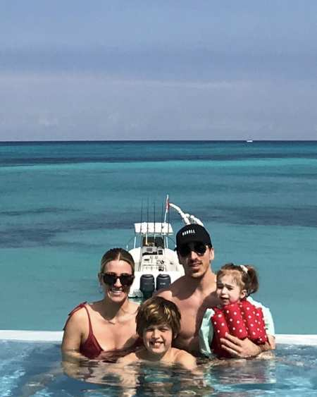 Katrina Sloane and Brad Marchand with their children on vacation. Explore more about Katrina & Brad's adventurous marital life.
