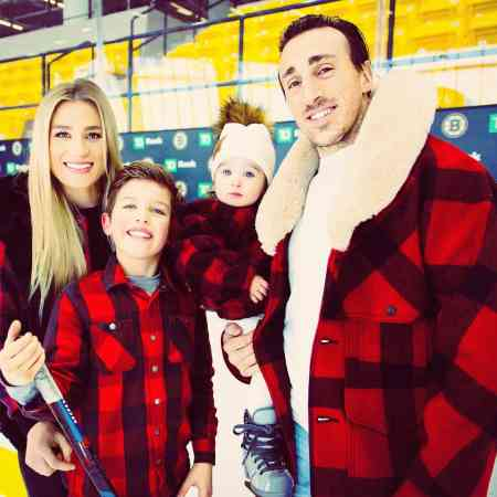 Katrina Sloane and her husband, Brad Marchand with their kids on Christmas Eve. Know more about the married couple's children.