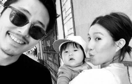 Steven Yeun with wife and son