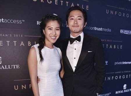 Actor Steven Yeun and his wife