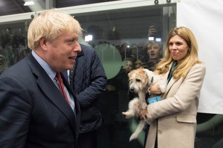 Boris Johnson and his Girlfriend Carrie Symonds with their dog, Dilyn