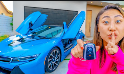 Lizzy Sharer And Her Expensive Car